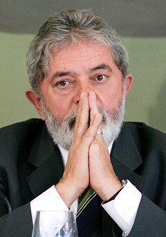 Luiz Inacio Lula da Silva, Brazil's president, attends a meeting regarding changes in the Brazilian tax system at the Planalto Palace in Brasilia, Brazil, on Thursday, Feb. 27, 2008. Brazil posted a budget surplus of 5.53 billion reais ($3.3 billion) in January, and Finance Minister Guido Mantega said that the country's tax code will boost economic growth to 5.5 percent. Photographer: Adriano Machado/Bloomberg News
